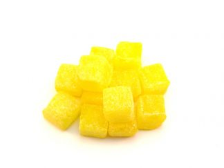 Pineapple Cubes are traditional sweets favoured with pineapple and shaped into yellow cubes