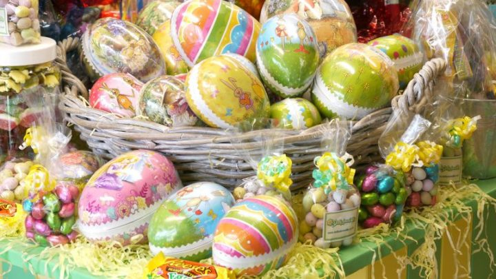 Colourful Easter themed image showing continental style Easter Eggs and seasonal chocolates and sweets