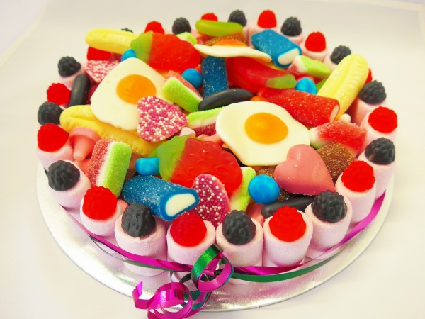 A close up shot of one of our candy cakes made entirely of sweets and using jelly and gummy sweets and chocolate