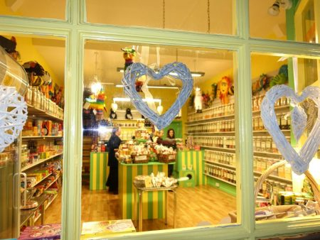 Photo taken at night showing the inside of DaffyDownDilly and some of the huge range of sweets!
