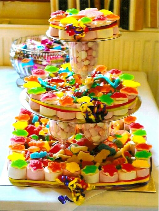 A colourful and attractive three tied sweet cake that we made for a customers wedding. Containing a wonderful mix of fizzy and jelly sweets