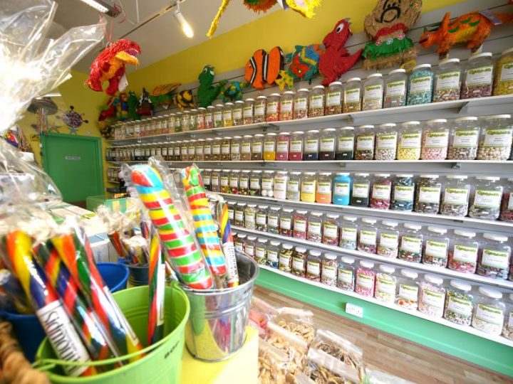 An internal photo of our Devon based sweet shop showing some of our 350 sweet jars and various rocks and pinatas