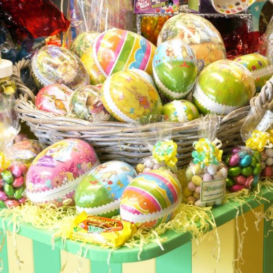 A beautiful image of traditional continental cardboard Easter eggs with associated seasonal Easter sweets