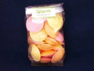 Clear bag of colourful Flying saucers sweets with a dark background