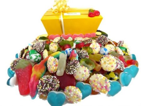 the entire colourful contents of one of our Kilo boxes of assorted quality sweets. jellies sweets, fizzy sweets and chocolates all make for the most delicious and colourful display.