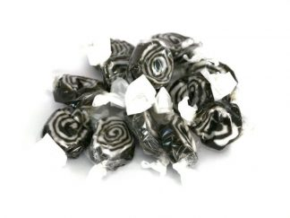 a close up image of Liquorice Swirls, a liquorice toffee type sweet that is individually wrapped