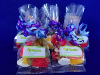 multiple clear bags finished with ribbons and filled with assorted Haribo sweets - perfect for a party bag