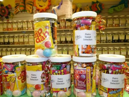 Retro sweet jars and a selection of fizzy sweets, jelly sweets and chocolate