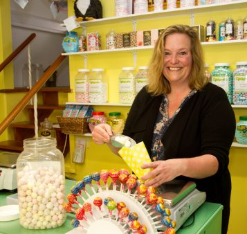 Natalie Brittain serving sweets in DaffyDownDilly