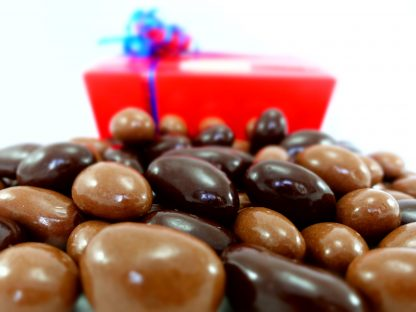 Milk and plain dark chocolate Brazils in a gift box